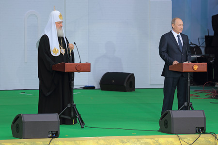 rus: MOSCOW REGION, SERGIYEV POSAD, RUSSIA - JUL 18, 2014: President of Russia Vladimir Putin and Patriarch of Moscow and all Rus Kirill (Vladimir Mikhailovich Gundyayev) at the ceremony of celebration of the 700th anniversary of the birthday of St. Sergius o