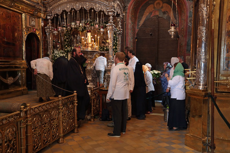 sacred trinity: MOSCOW REGION, SERGIYEV POSAD, RUSSIA - JUL 18, 2014: Trinity Lavra of St. Sergius. Celebration of the 700th anniversary of the birthday of St. Sergius of Radonezh. Pilgrims worship the Holy relics of Sergius of Radonezh in the Holy Trinity Cathedral Editorial
