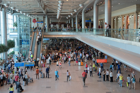 significant: MOSCOW, RUSSIA - AUG 04, 2013: Domodedovo international airport. Significant passenger traffic in the midst of the holiday season Editorial