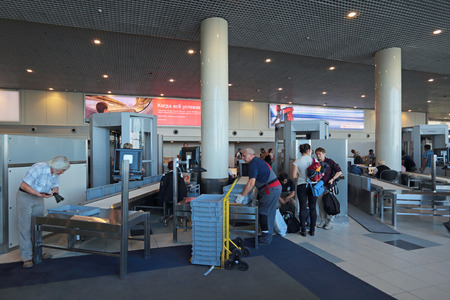 to inspect: MOSCOW, RUSSIA - AUG 04,2014: Increased security measures. Screening of passengers at the building of the international airport Domodedovo