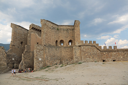 sudak: SUDAK, REPUBLIC OF CRIMEA, RUSSIA - AUG 07, 2014: The ruins of the medieval Genoese fortress in Sugdeya city (currently - Sudak). The main entrance