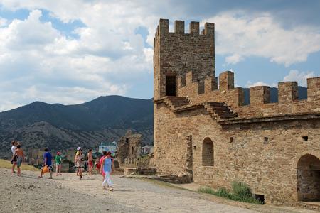 sudak: SUDAK, REPUBLIC OF CRIMEA, RUSSIA - AUG 07, 2014: The ruins of the medieval Genoese fortress in Sugdeya city (currently - Sudak). Tower Corrado Cigala