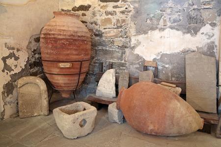 sudak: SUDAK, REPUBLIC OF CRIMEA, RUSSIA - AUG 07, 2014: Medieval pithos and gravestones of the excavation of the medieval Sugdeya city (currently - Sudak), Genoese fortress museum