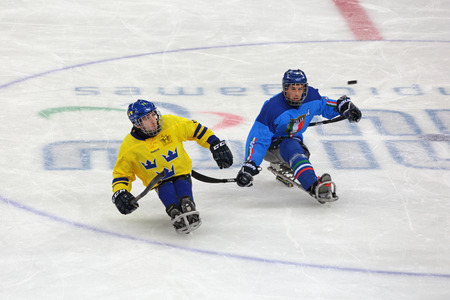 SOCHI, RUSSIA - MAR 12, 2014: Paralympic winter games in ice Arena Shayba. The sledge hockey, match Italy-Sweden
