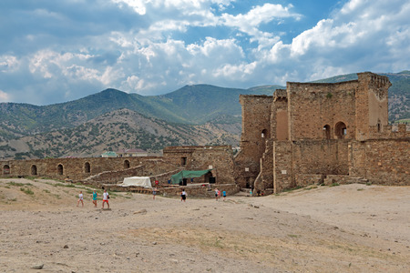SUDAK, REPUBLIC OF CRIMEA, RUSSIA - AUG 07, 2014: The ruins of the medieval Genoese fortress in Sugdeya city (currently - Sudak). The main entrance