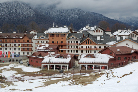 SOCHI, ADLER DISTRICT, KRASNODAR KRAI, RUSSIA - MAR 14, 2014: Mountain Olympic village at Rosa Khutor, Krasnaya Polyana - the place of residence of the athletes of the winter Olympic games 2014