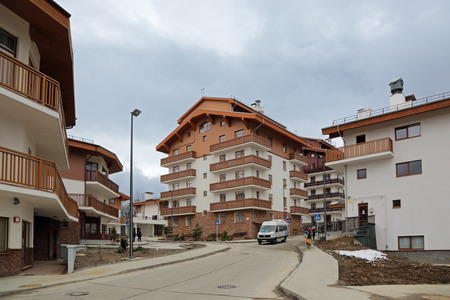 olympiad: SOCHI, ADLER DISTRICT, KRASNODAR KRAI, RUSSIA - MAR 14, 2014: Mountain Olympic village at Rosa Khutor, Krasnaya Polyana - the place of residence of the athletes of the winter Olympic games 2014