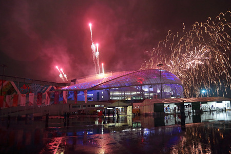 fisht: SOCHI, ADLER, RUSSIA - MAR 16, 2014: Olympic Park in Adlersky District, Krasnodar Krai. Fireworks over the Fish Olimpic Stadium during the closing ceremony of the Paralympic winter games 2014