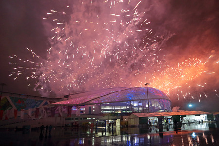 stadia: SOCHI, ADLER, RUSSIA - MAR 16, 2014: Olympic Park in Adlersky District, Krasnodar Krai. Fireworks over the Fish Olimpic Stadium during the closing ceremony of the Paralympic winter games 2014