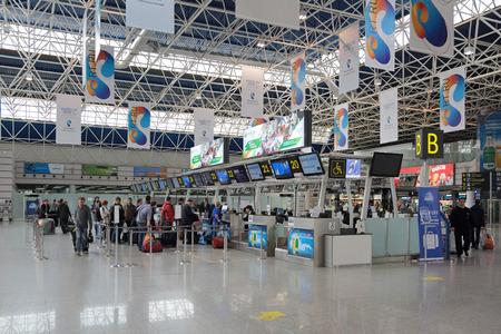 front desk: SOCHI, KRASNODAR REGION, RUSSIA - MAR 21, 2014: Adler international airport. Passengers at the front Desk Editorial