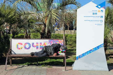 destitute: SOCHI, RUSSIA - MAR 23, 2014: The HOMELESS man sleeping on a bench in the city street Editorial
