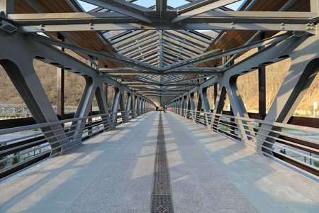 bridged: SOCHI, RUSSIA - MAR 26, 2014: Pedestrian bridge over the river Mzymta at Rosa Khutor Alpine ski Resort in Krasnaya Polyana - popular center of skiing and snowboard