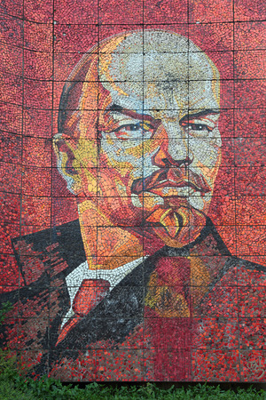 theorist: SOCHI, RUSSIA - MAR 27, 2014: The old Soviet mosaic with the image of a portrait of Lenin on the street Egorova