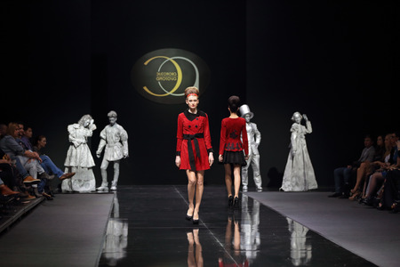 MOSCOW, RUSSIA - MAR 30, 2014: Moscow Fashion Week in Gostiny Dvor. Demonstration models of clothes on the catwalk from Moscow designer Eleonora Amosova