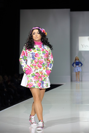 lolita: MOSCOW, RUSSIA - APR 1, 2014: Moscow Fashion Week in Gostiny Dvor. Russian Pop singer, actress, TV and film director Lolita Milyavskaya takes part in fashion show the collection of clothing designer YanaStasia Editorial