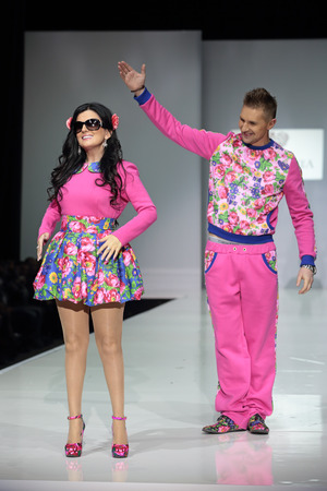 diana: MOSCOW, RUSSIA - APR 1, 2014: Moscow Fashion Week in Gostiny Dvor. Russian blind singer Diana Gurtskaya takes part in fashion show the collection of clothing designer YanaStasia