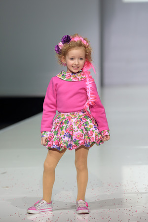 kiddie: MOSCOW, RUSSIA - APR 1, 2014: Moscow Fashion Week in Gostiny Dvor. Demonstration models of clothes on the catwalk from russian brand YanaStasia