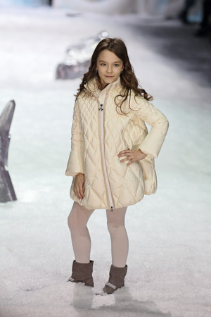 kiddie: MOSCOW, RUSSIA - APR 01, 2014: Moscow Fashion Week in Gostiny Dvor. Demonstration models of clothes on the catwalk from russian brand ODRI