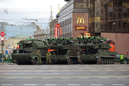 tracked: MOSCOW, RUSSIA - MAY 05, 2014: Rehearsal celebration of the 69th anniversary of the Victory Day (WWII). Military equipment on Tverskaya street prepares to travel to the Red Square. Buk missile system (air defense complex SA-11 Gadfly)