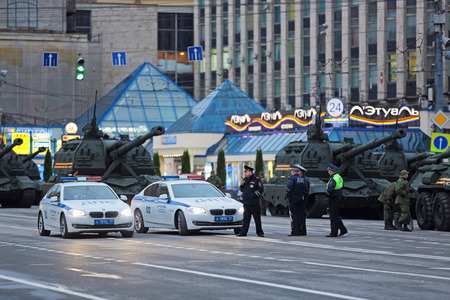 propelled: MOSCOW, RUSSIA - MAY 05, 2014: Rehearsal celebration of the 69th anniversary of the Victory Day (WWII). A police cordon around military equipment on Tverskaya street prepares to travel to the Red Square