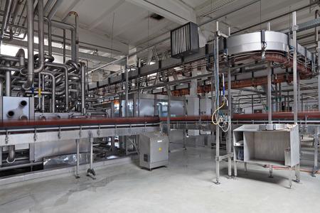 The food industry. Bottling of beer brewing plant conveyor line
