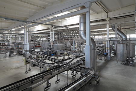 Manufacturing plant: The food industry. Bottling of beer brewing plant conveyor line
