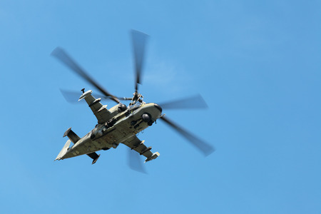 military helicopter: A military helicopter flying on the blue sky Editorial