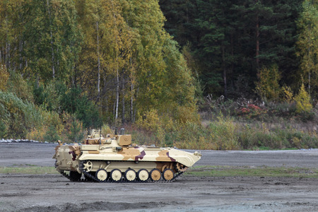 industrially: Military armoured vehicle - mobile reconnaissance post goes along the forest