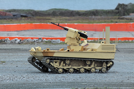 tracked: Remote controlled tracked robot machine gun