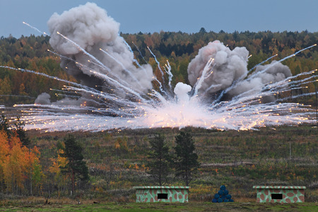 oudoors: The explosion of the ammunition at a military training ground Stock Photo