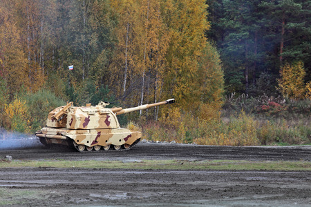industrially: Heavy self-propelled howitzer going along the forest, nobody Stock Photo