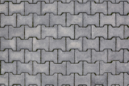 footway: The texture of the sidewalk old tile