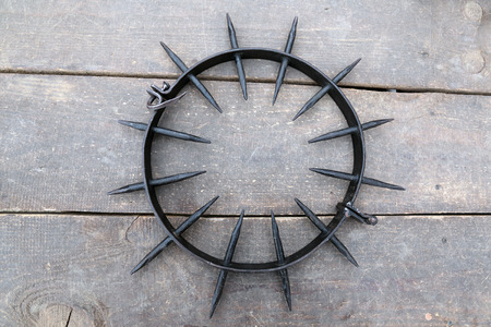Medieval instrument of torture Spiked Punishment Collar (iron collar, spanish collar) on wooden