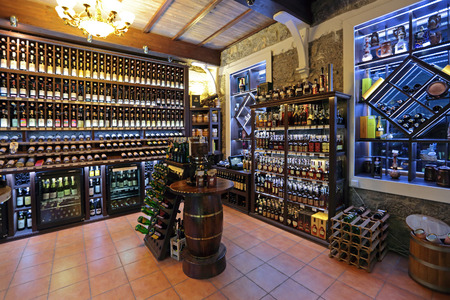 booze: YALTA, REPUBLIC OF CRIMEA, RUSSIA - AUG 14, 2014: Interior and assortment drinks wine shop with traditional Crimean wines, nobody