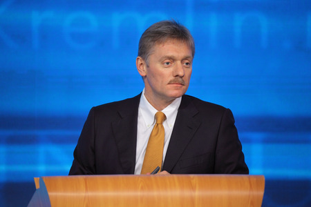 attache: MOSCOW, RUSSIA - DEC 19, 2013: The Dmitry Sergeyevich Peskov - Press Attache for the President of Russian Federation Vladimir Putin, Deputy head of the Presidential at annual press conference in Center of international trade