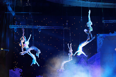 MOSCOW, RUSSIA - JAN 06, 2013: Childrens new year performance Circus Santa Claus II - Olympic New Year in Olympic Stadium (sport complex). The performance of the trapeze artists