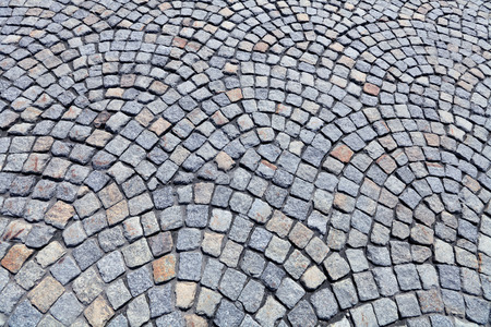 paved: The roadway paved by a grey granite Stock Photo