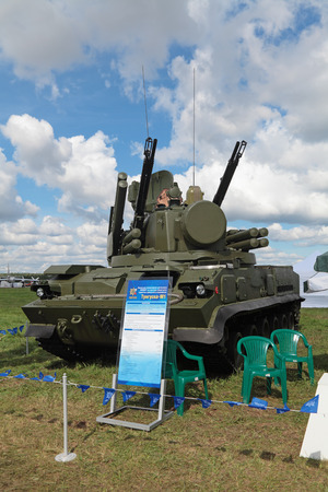 armaments: ZHUKOVSKY, RUSSIA - AUG 26, 2013: The anti-aircraft air defense cannon-missile complex 9K22 Tunguska at the International Aviation and Space salon MAKS-2013