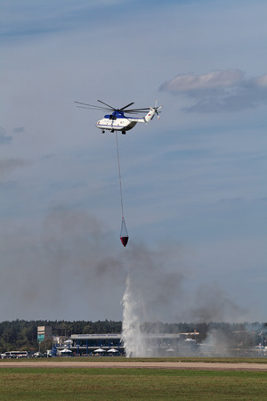 fire extinguishing: ZHUKOVSKY, RUSSIA - AUG 28, 2013: Demonstration of fire extinguishing with the helicopter Mi-26 at the International Aviation and Space salon MAKS-2013 Editorial