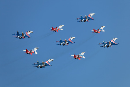 ZHUKOVSKY, RUSSIA - AUG 28, 2013: Аerobatic teams Swifts (Strizhi) on planes MiG-29 and Russian Knights on planes Su-27 at the International Aviation and Space salon MAKS-2013