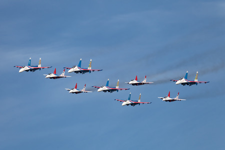 supersonic: ZHUKOVSKY, RUSSIA - AUG 28, 2013: Аerobatic teams Swifts (Strizhi) on planes MiG-29 and Russian Knights on planes Su-27 at the International Aviation and Space salon MAKS-2013
