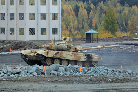 industrially: NIZHNY TAGIL, RUSSIA - SEP 25, 2013: The international exhibition of armament, military equipment and ammunition RUSSIA ARMS EXPO (RAE-2013). The T-72 is a Soviet second-generation main battle tank