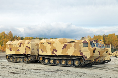 armament: NIZHNY TAGIL, RUSSIA - SEP 26, 2013: The international exhibition of armament, military equipment and ammunition RUSSIA ARMS EXPO (RAE-2013). Two-tier tracked all-terrain amphibian vehicle Editorial