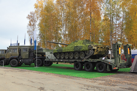 industrially: NIZHNY TAGIL, RUSSIA - SEP 26, 2013: The international exhibition of armament, military equipment and ammunition RUSSIA ARMS EXPO (RAE-2013). Semi-heavy-duty vehicle automobile for transportation of armored vehicles