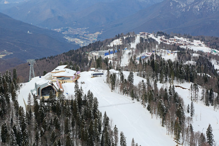 krasnodar region: SOCHI, RUSSIA - MAR 02, 2014: Krasnaya Polyana - alpine ski Resort, venue for the 2014 winter sports competitions. The The ski and biathlon complex Laura, Psekhako Ridge, top view Editorial