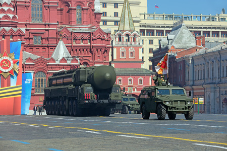 supersonic: MOSCOW, RUSSIA - MAY 09, 2014: Celebration of the 69th anniversary of the Victory Day (WWII). Solemn passage of military hardware on Red Square. The RT-2UTTKh Topol-M (SS-27 Sickle B) intercontinental ballistic nuclear missile complex strategic purpos Editorial