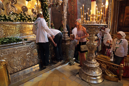 sacred trinity: MOSCOW REGION, SERGIYEV POSAD, RUSSIA - JUL 18, 2014: Trinity Lavra of St. Sergius. Celebration of the 700th anniversary of the birthday of St. Sergius of Radonezh. Pilgrims worship the Holy relics of Sergius of Radonezh in the Holy Trinity Cathedral Editorial