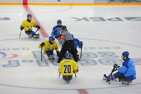 paralympic: SOCHI, RUSSIA - MAR 12, 2014: Paralympic winter games in ice Arena Shayba. The sledge hockey, match Italy-Sweden