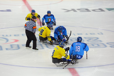 olympiad: SOCHI, RUSSIA - MAR 12, 2014: Paralympic winter games in ice Arena Shayba. The sledge hockey, match Italy-Sweden