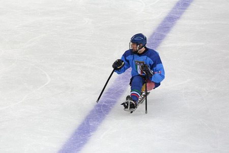 SOCHI, RUSSIA - MAR 12, 2014: Paralympic winter games in ice Arena Shayba. The sledge hockey, match Italy-Sweden. The Italian team player